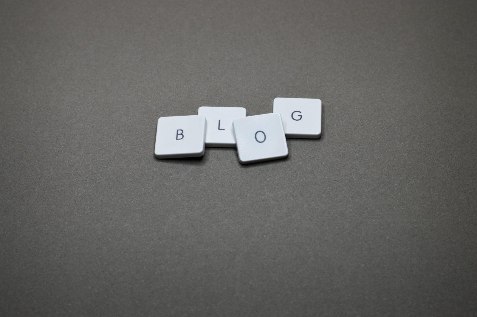 White buttons on a grey background that spell out 'BLOG'.